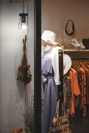 assorted-hanged-clothes-near-white-light-bulb-1233648